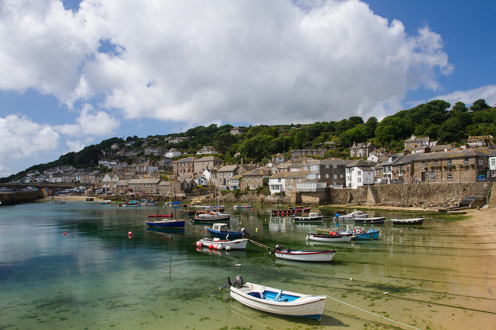 MOUSEHOLE, CORNWALL, UK - . The picturesque Cornish fishing village of Mousehole in Cornwall with its small harbour and surrounding fishermen's cottages is a popular tourist destination in England.