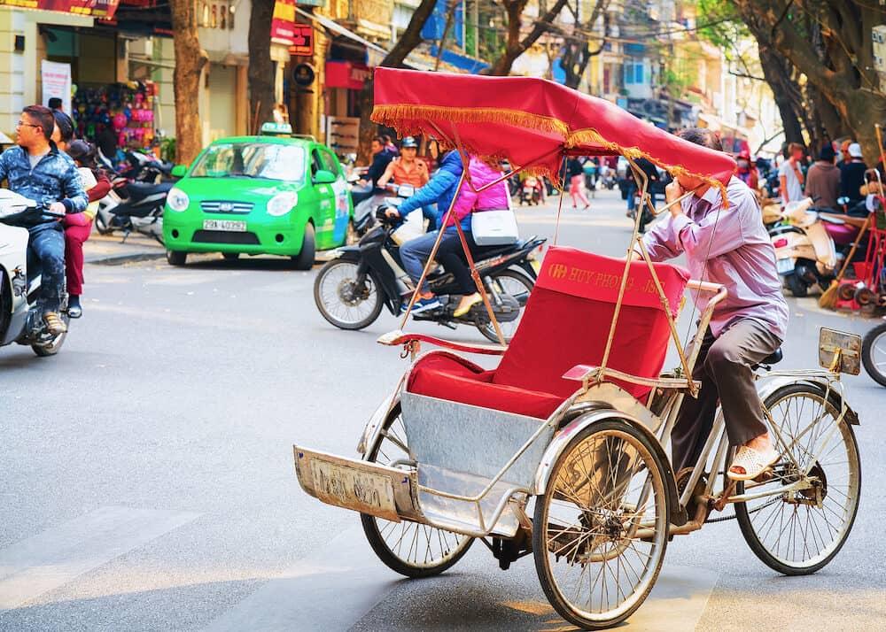 Hanoi, Vietnam - Cycle rickshaw on busy street in Hanoi, Vietnam