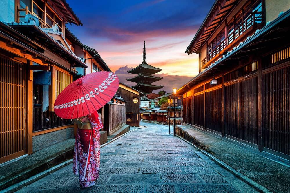 Asian woman wearing japanese traditional kimono at Yasaka Pagoda and Sannen Zaka Street in Kyoto, Japan.Asian woman wearing japanese traditional kimono at Yasaka Pagoda and Sannen Zaka Street in Kyoto, Japan.