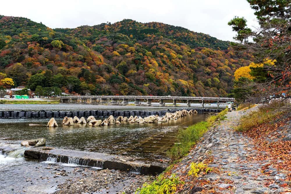 Togetsukyo bridge over Katsura river with autumn foliage color in Arashiyama Kyoto Japan