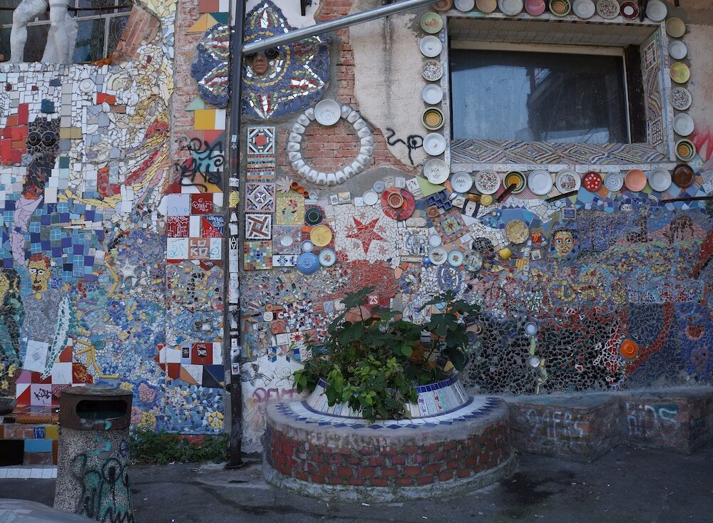 LJUBLJANA, SLOVENIA - : Graffitti, sculpture and mosaics on a wall in squat located in Metelkova street in Ljubljana, Slovenia