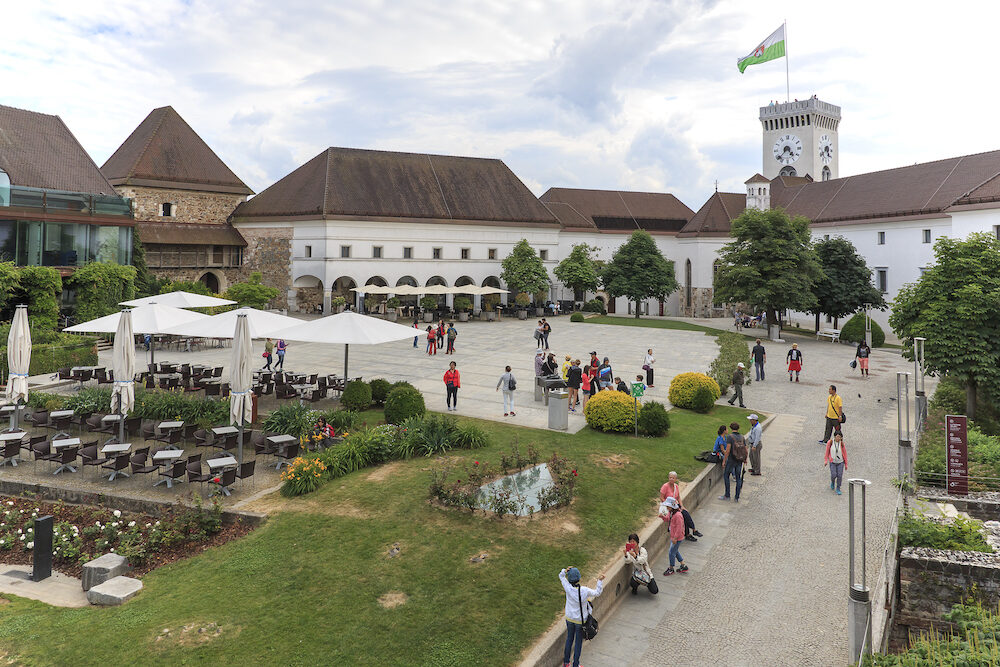 Ljubljana Slovenia - View of the square inside the castle of Ljubljana and several tourists passing by