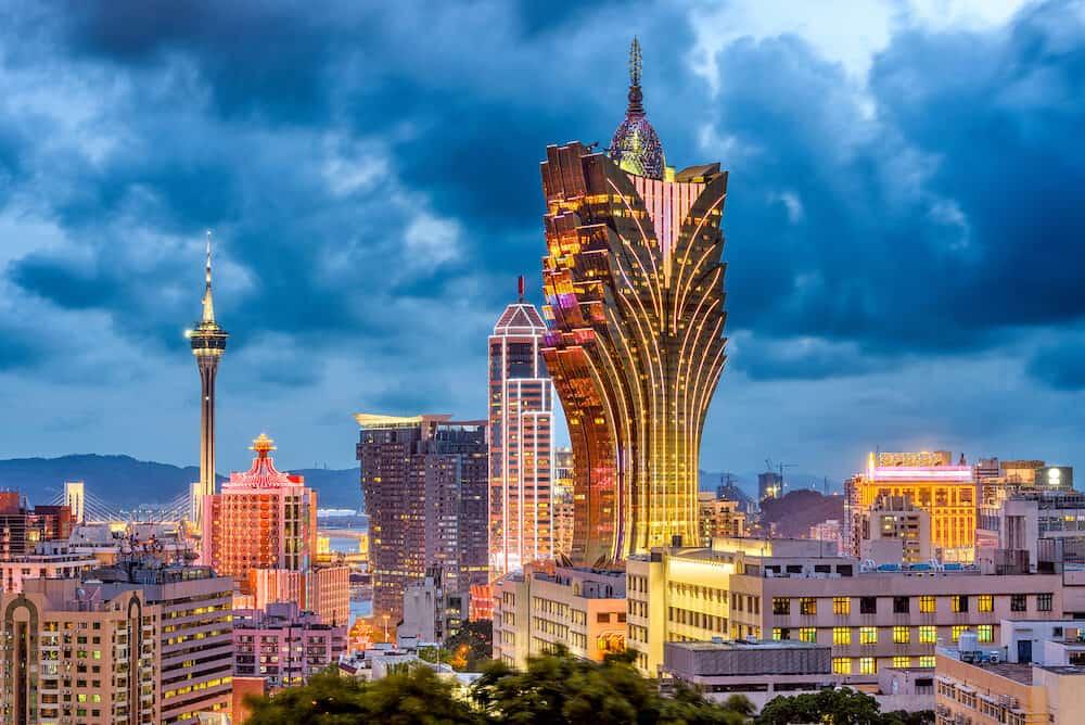 Macau, China city skyline at dusk.