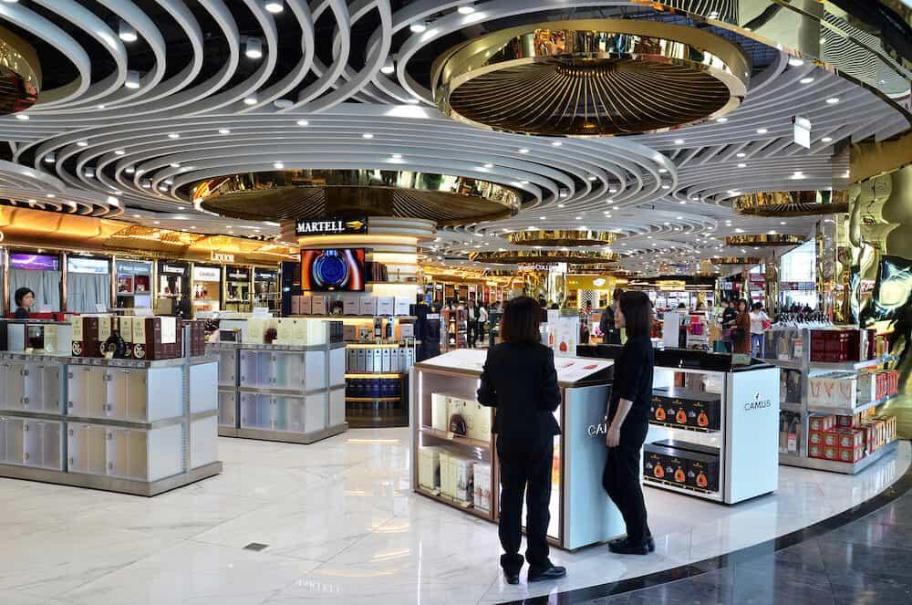 MACAU, CHINA- Passengers do some shopping in the duty free shop in Macau International Airport.