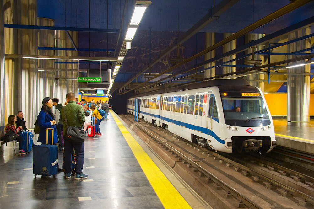 MADRID SPAIN - : Metro train arrives at Madrid metro platform. The Madrid Metro is a metro system serving the city of Madrid 7th longest metro in the world with total length of 293 km