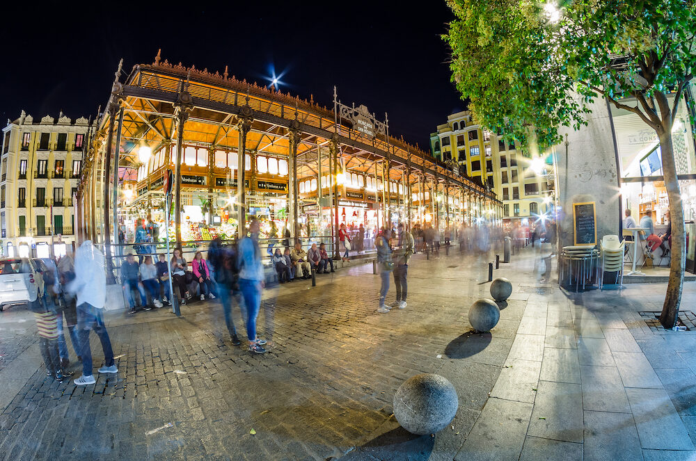 "MADRID, SPAIN - : Night view of the ""Mercado de San Miguel"" (Market of San Miguel), popular among tourists, not a traditional grocery market but a gourmet tapas market, located in the center of Madrid, built in 1916, renovated in 2009"