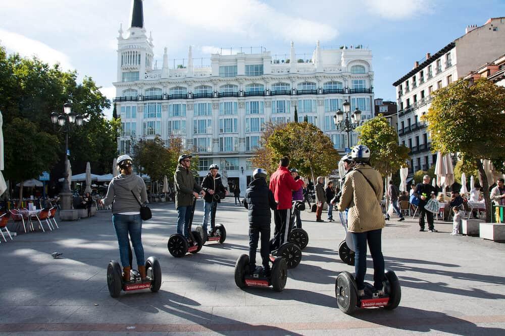 MADRID SPAIN - : Tourists sightseeing on segway tour of Madrid on Plaza de Santa Ana