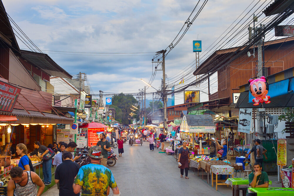 PAI, THAILAND - People walking on Pai night market at twilight. Pai is the famous tourist attraction in Thailand