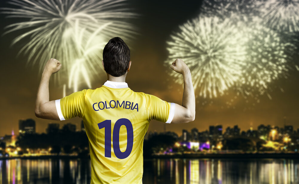 Colombian soccer player celebrates the victory after the match