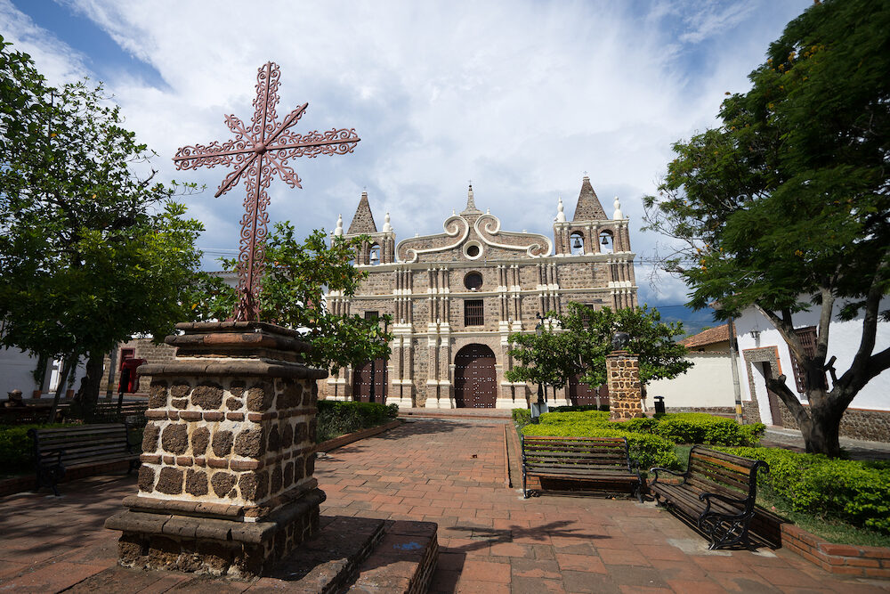 colonial church with iron cross in front in Santa Fe de Antioquia in Colombia