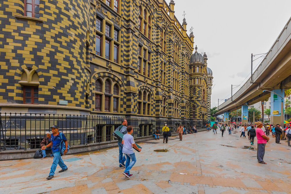Medellin In the morning, tourists stop to admire the Gothic architecture of the Rafael Uribe Palace of culture located in the center of Medellin