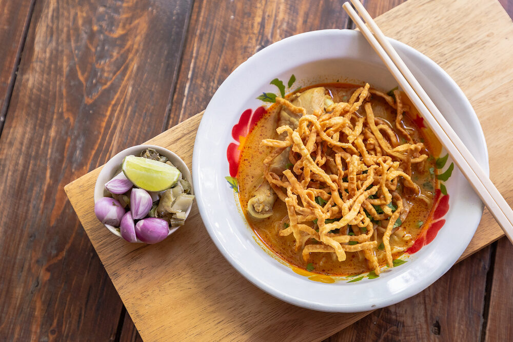 Khao Soi. Curried Noodle Soup Thailand call Khao Soi. Khao Soi thai food style. Noodle Curry Soup or Khao Soi with chicken. Khao soi Traditional Thai Food. Thai noodle curry soup with chicken.