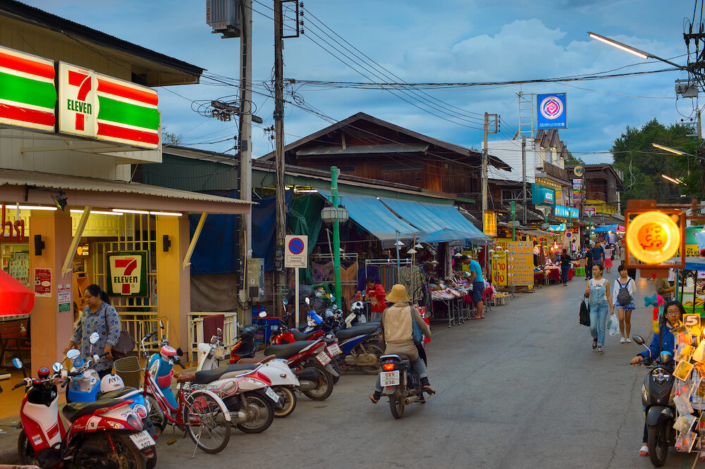 PAI, THAILAND -People walking on Pai night market at twilight. Pai is the famous tourist attraction in Thailand