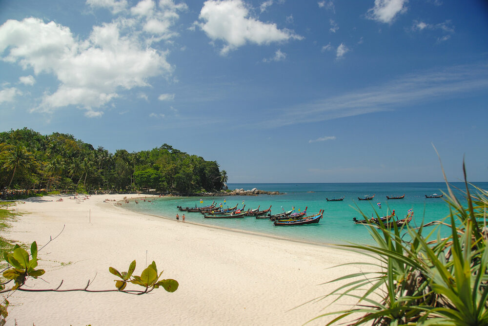 View of white sand tropical freedom beach bay in Phuket Thailand