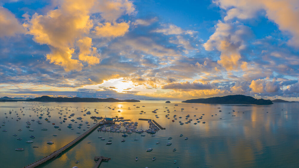 aerial view sunrise above Chalong gulf. Chalong marina is a center for intense boating activity. at Chalong pier is a large port in Phuket there have two bridges to transport and service for tourists