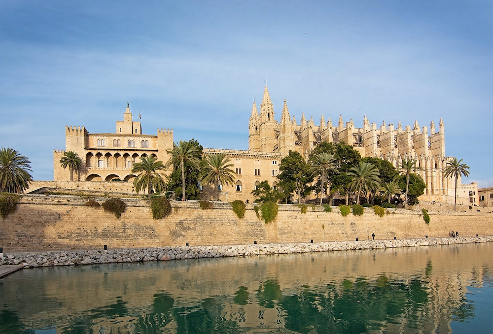 MALLORCA, BALEARIC ISLANDS, SPAIN - Landmarks La Seu cathedral and Almudaina castle in Palma de Mallorca on a sunny day in Mallorca, Balearic islands, Spain.