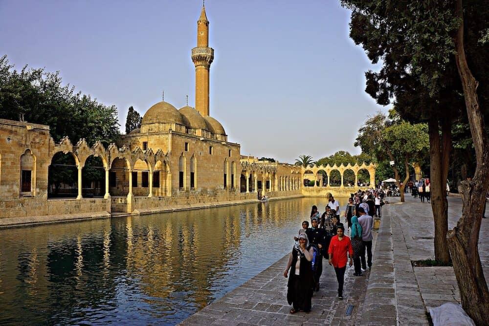 SANLIURFA, TURKEY - people at Balikligol, Halilurrahman Mosque Sanliurfa