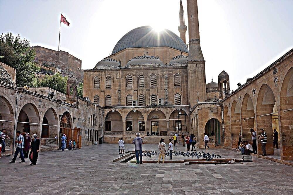 SANLIURFA, TURKEY - people at courtyard of Dergah Mosque, near Balikligol in Sanliurfa.