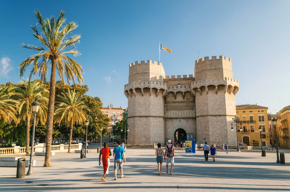 Valencia Spain - Tourists walk in front of The Serrans Gate or Serranos Gate Valencian Towers is part of the ancient city wall. Landmark of Valencia