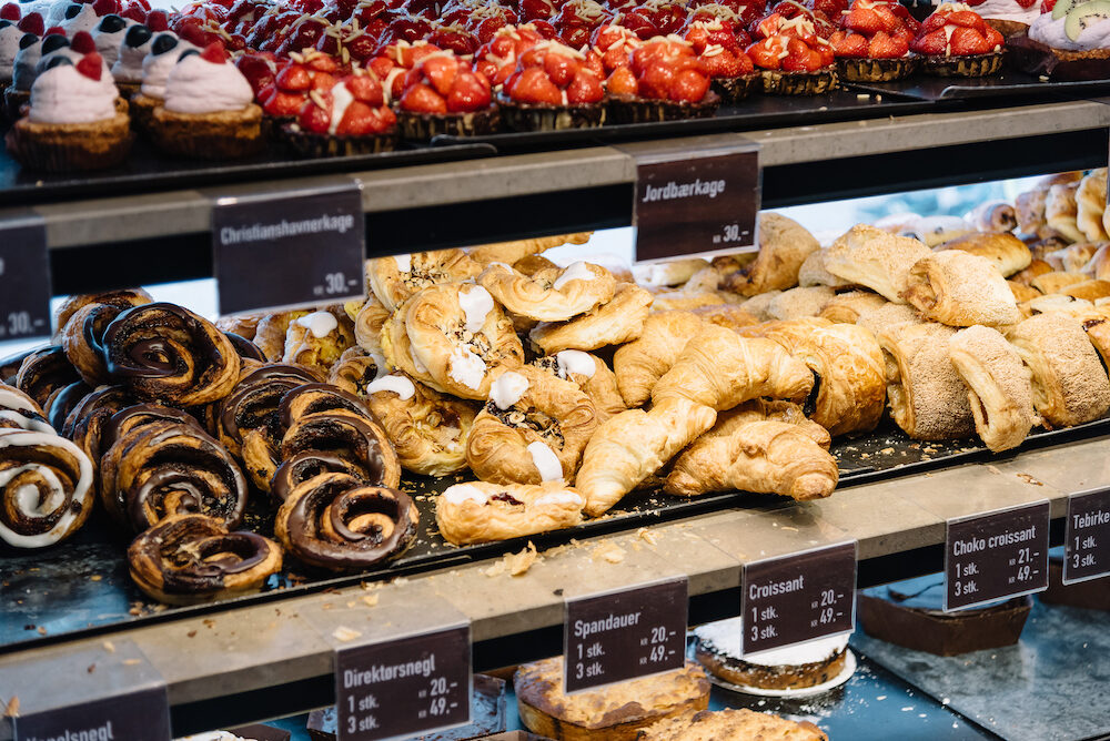 Cinnamon Danish swirls croissants and other pastry in cafe