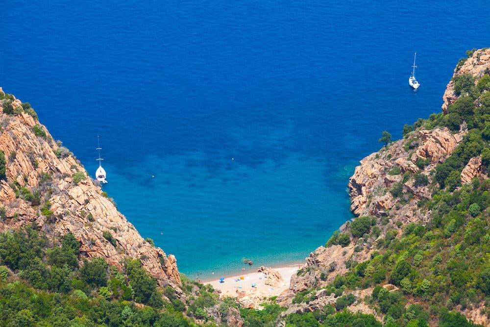 Coastal landscape of South Corsica. Small wild beach on Capo Rosso Piana region