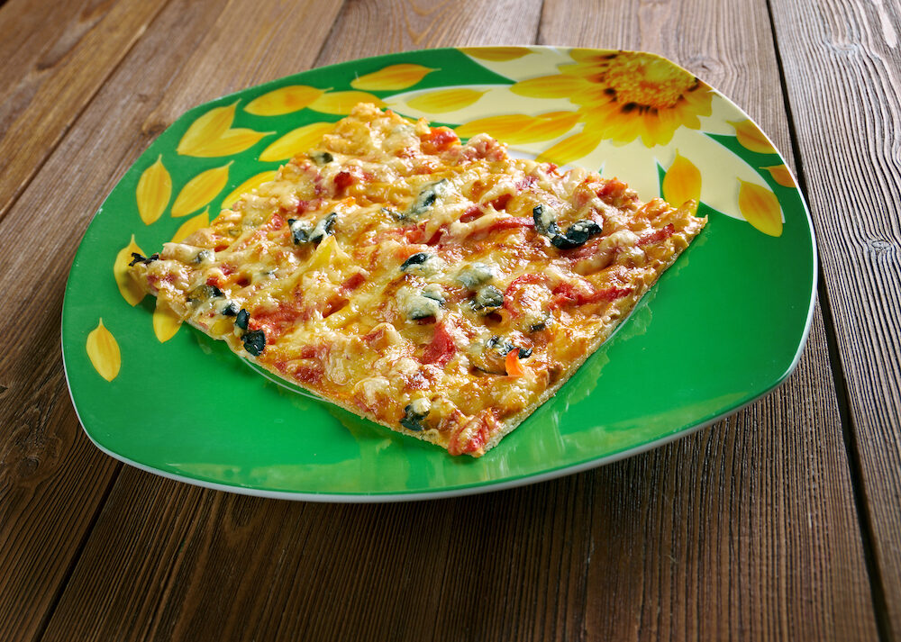 Sicilian pizza is pizza prepared in a manner that originated in Sicily Italy. with thick-crust or deep-dish pizza.