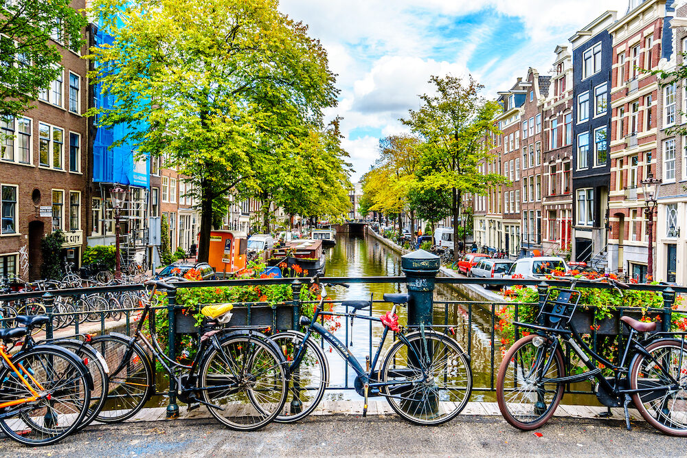 Amsterdam, the Netherlands - Historic Gable Houses along the Bloemgracht viewed from the Tweede Leliedwarsstreet Bridge in the historic Jordaan district in the old center of Amsterdam