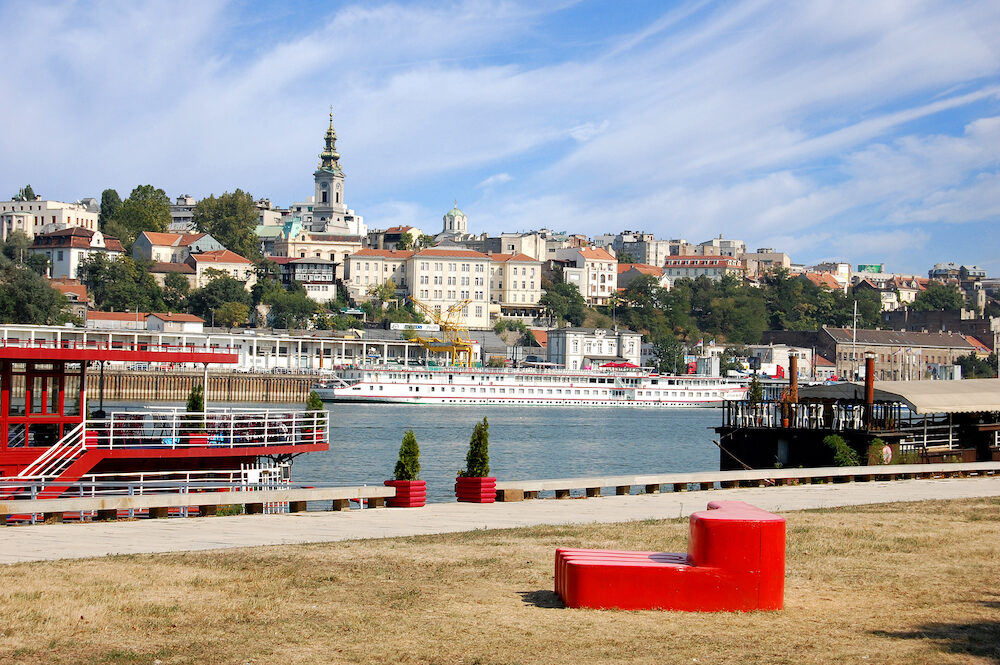 Belgrade Serbia. . Belgrade Old Town. with red park sculpture. View from New Belgrade, on the Sava River, the Belgrade port and the Cathedral Church.