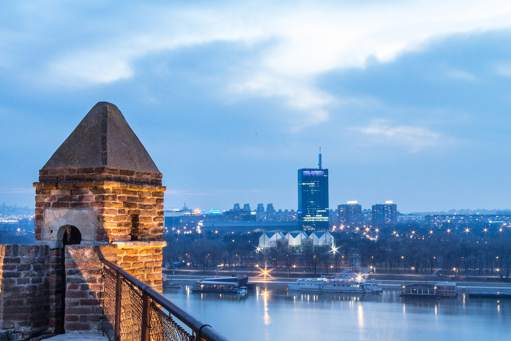 BELGRADE, SERBIA - Skyline of New Belgrade (Novi Beograd) seen in the early evening from the Kalemegdan fortress. The main landmarks of the district, such as Usce can be seen