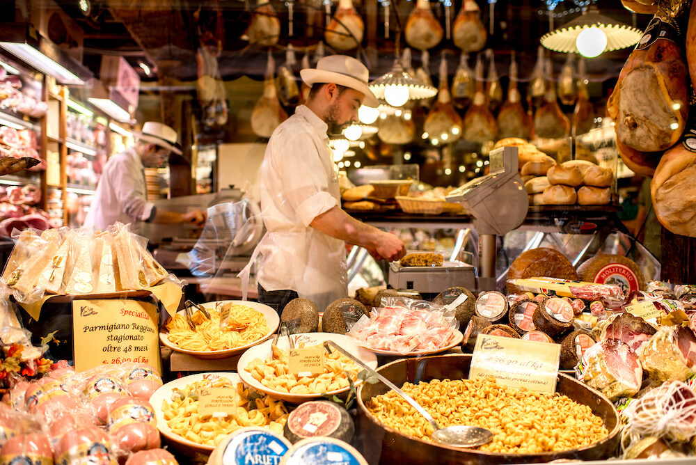 Bologna, Italy - Food store showcase full of food in Bologna city in Italy
