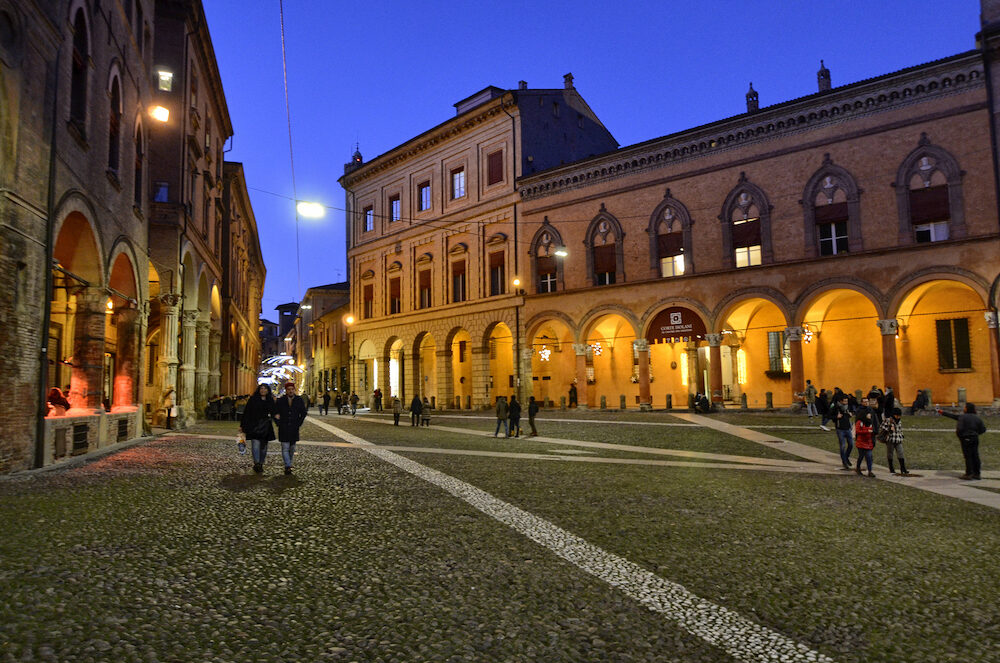 Bologna, Emilia Romagna, Italy. . The square is called of the seven churches: the basilica of Santo Stefano is a complex of religious buildings. The real name is Piazza Santo Stefano. People stroll.