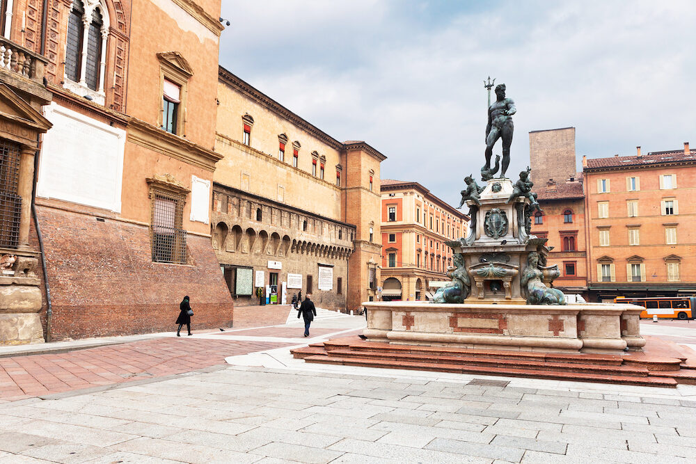 view on Sala Borsa and Fountain of Neptune on Piazza del Nettuno in Bologna Italy in autumn day