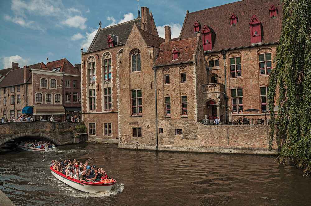Bruges, Belgium - Boats and old buildings on the canal edge at Bruges. With many canals and old buildings, this graceful town is a World Heritage Site of Unesco. Northwestern Belgium.