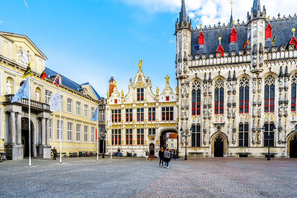 Brugge/Belgium - Historic buildings of the Town Hall, and the old Civil Registrar of the Brugse Vrije in the center, on Burg Square in the heart of medieval Bruges, Belgium