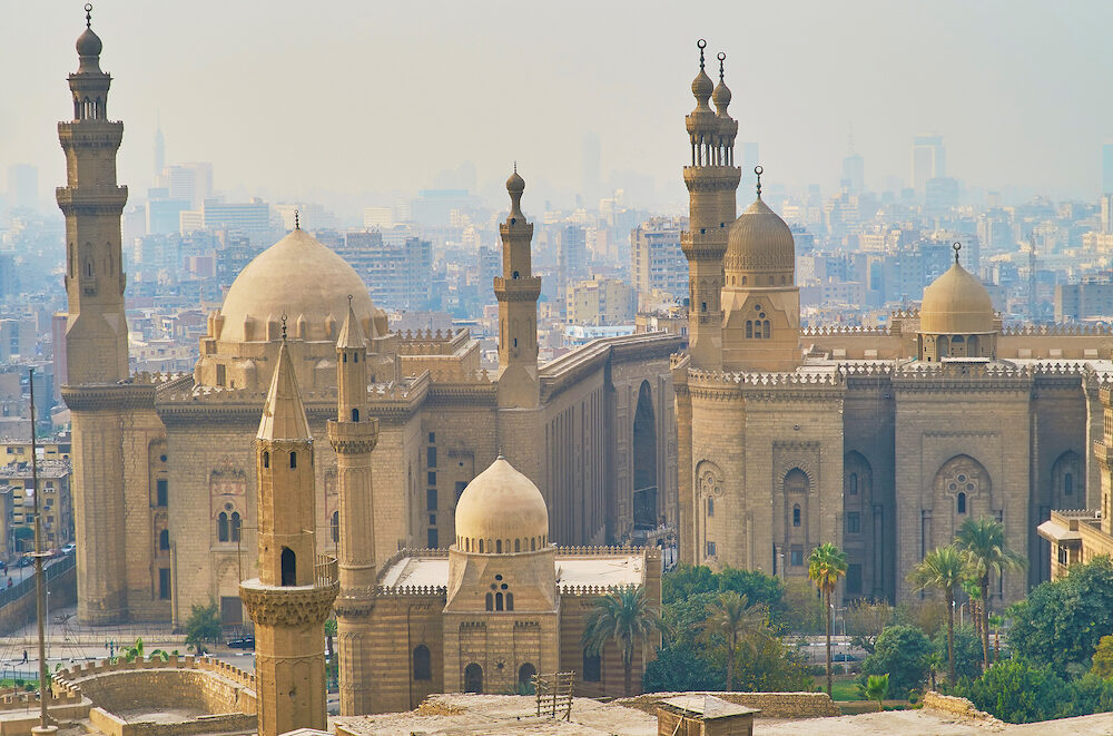Historic ensemble of Salah El-Deen square from the Saladin Citadel, overlooking the domes and minarets of Al Rifai', Sultan Hassan and Al-Mahmoudia mosques, Cairo, Egypt.