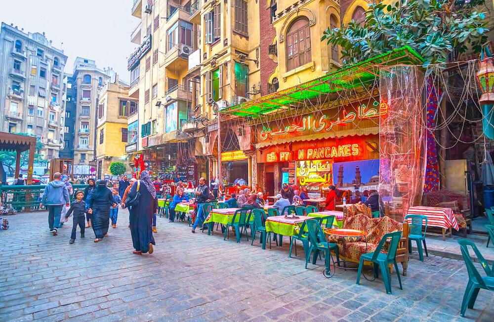 CAIRO, EGYPT - The open terraces of traditional Egyptian food cafes on the street at Khan El-Khalili market in Cairo.