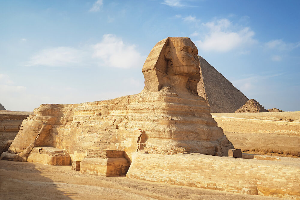 CAIRO, EGYPT - View of The Great Sphinx and pyramids on the Giza Plateau - one of the most famous tourist attractions in the world