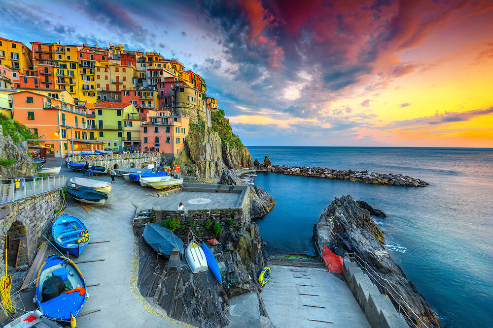 Admirable travel destination, wonderful mediterranean village with traditional colorful old houses and fishing boats at sunset, Manarola, Cinque Terre, Liguria, Italy, Europe