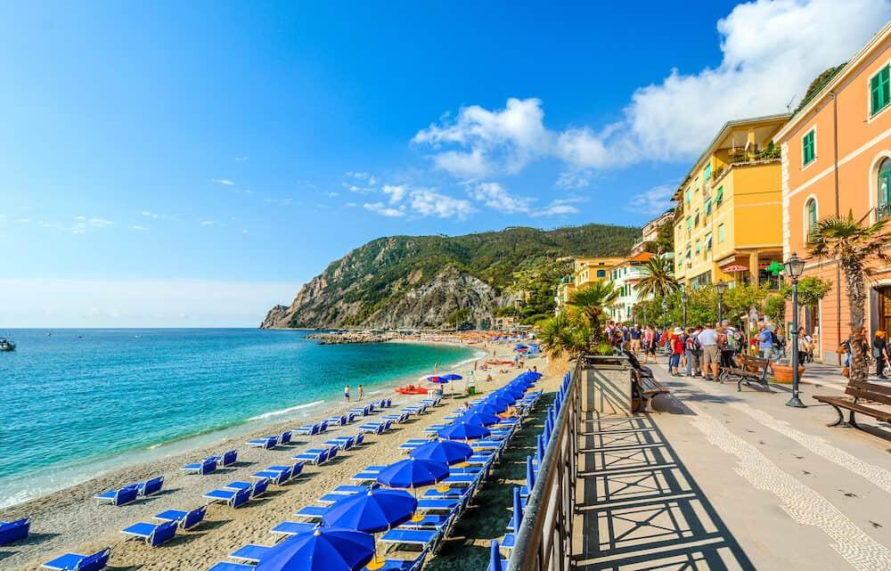 Monterosso Al Mare, Italy - The sea and sandy beach Spiaggia di Fegina at the Cinque Terre Italy resort village of Monterosso al Mare with tourists enjoying the Italian Riviera