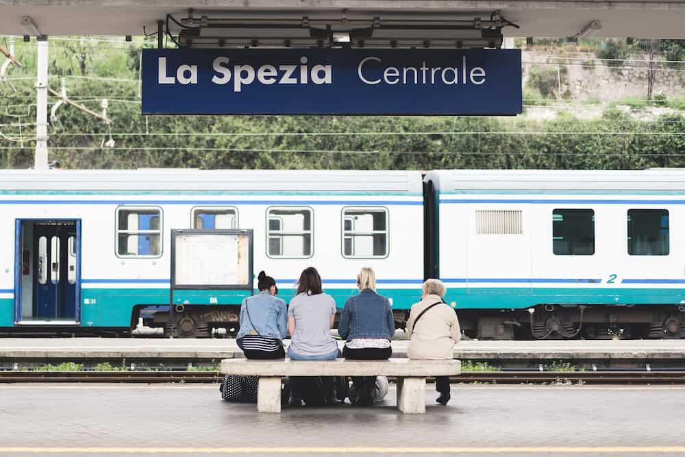 La Spezia Italy - Unidentified four European female travelers young and senior wait for train at La Spezia Central public train station visiting Cinque Terre Italy