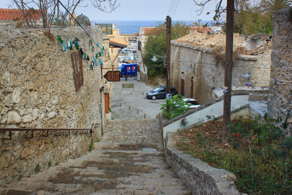 KYRENIA, CYPRUS - : Old stone staircase on one of the central streets of Kyrenia (Girne) leading to the Mediterranean Sea in Northern Cyprus.