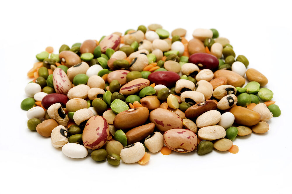 Dried legumes and cereals on a white background