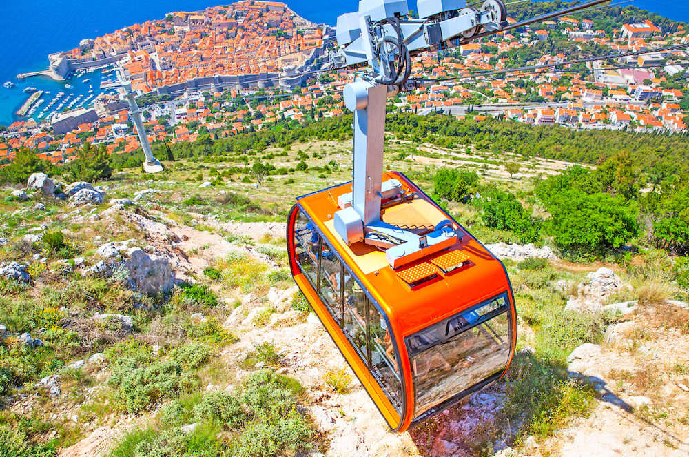 Cable way and panoramic view of Dubrovnik on sunny summer day, Croatia