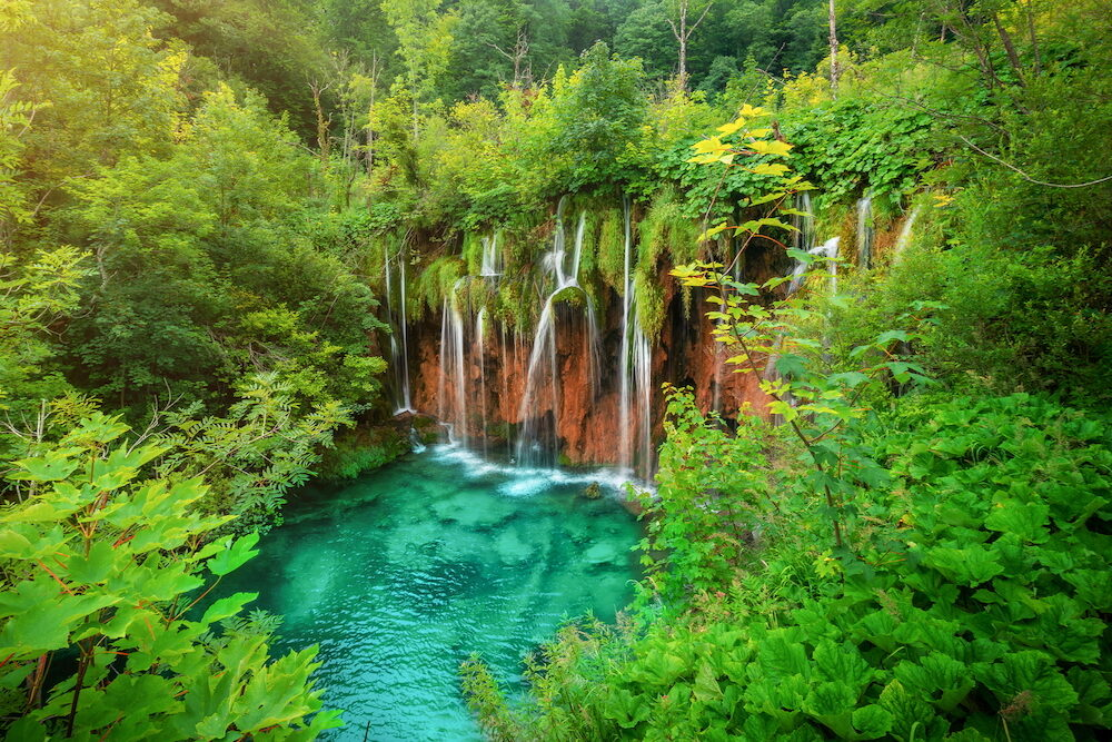 Exotic waterfall and lake landscape of Plitvice Lakes National Park, UNESCO natural world heritage and famous travel destination of Croatia. The lakes are located in central Croatia