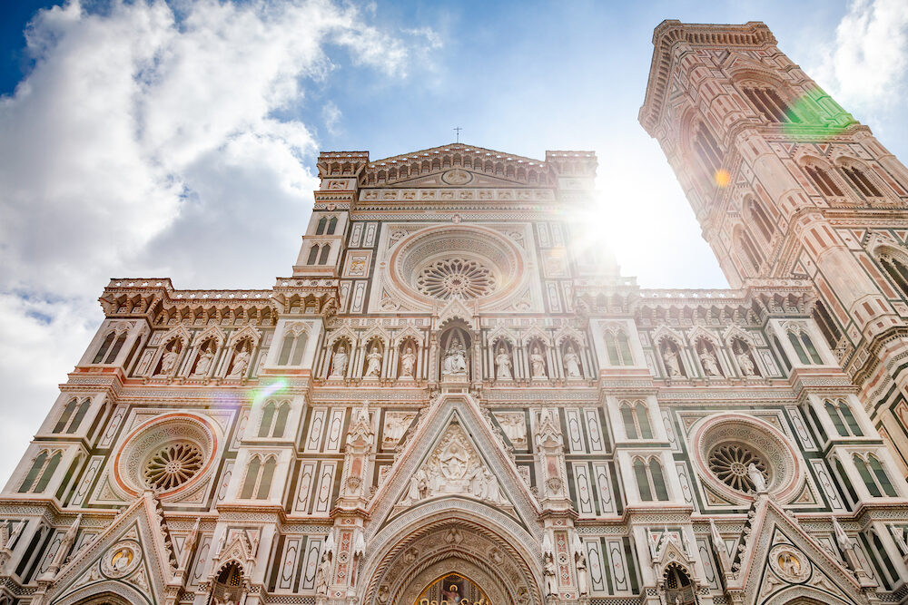 Ornate neo-gothic facade of the Cattedrale di Santa Maria del Fiore or Florence Cathedral (Il Duomo di Firenze), a famous UNESCO World Heritage Site and a major tourist attraction of Tuscany Italy