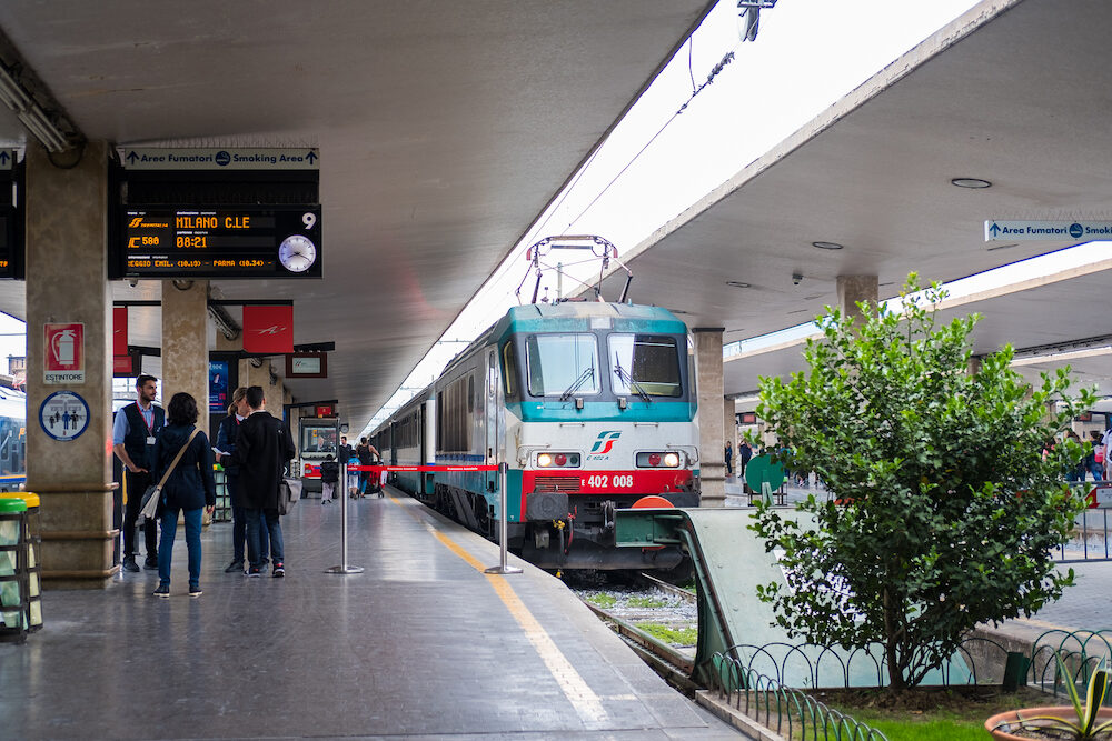 Florence, Italy -People walking at the platform with Train in Firenze Santa Maria Novella railway station in Florence, Italy.