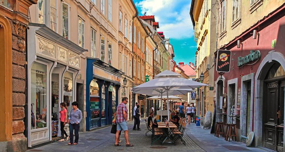 LJUBLJANA, SLOVENIA - Street in the old city center of Ljubljana with street shops and cafes.