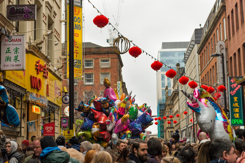 MANCHESTER, ENGLAND Chinese New Year 2018 Manchester Celebrations Parade, streets crowded with happy people
