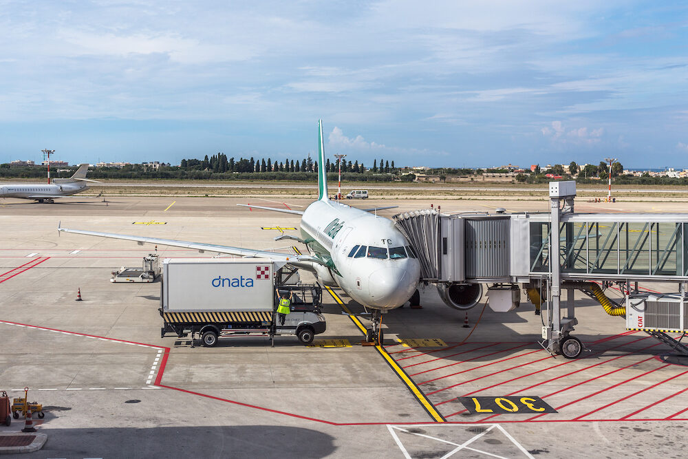 BARI, ITALY - An Alitalia aircraft at the gate at the Bari Palese airport for maintenance operations before the flight.