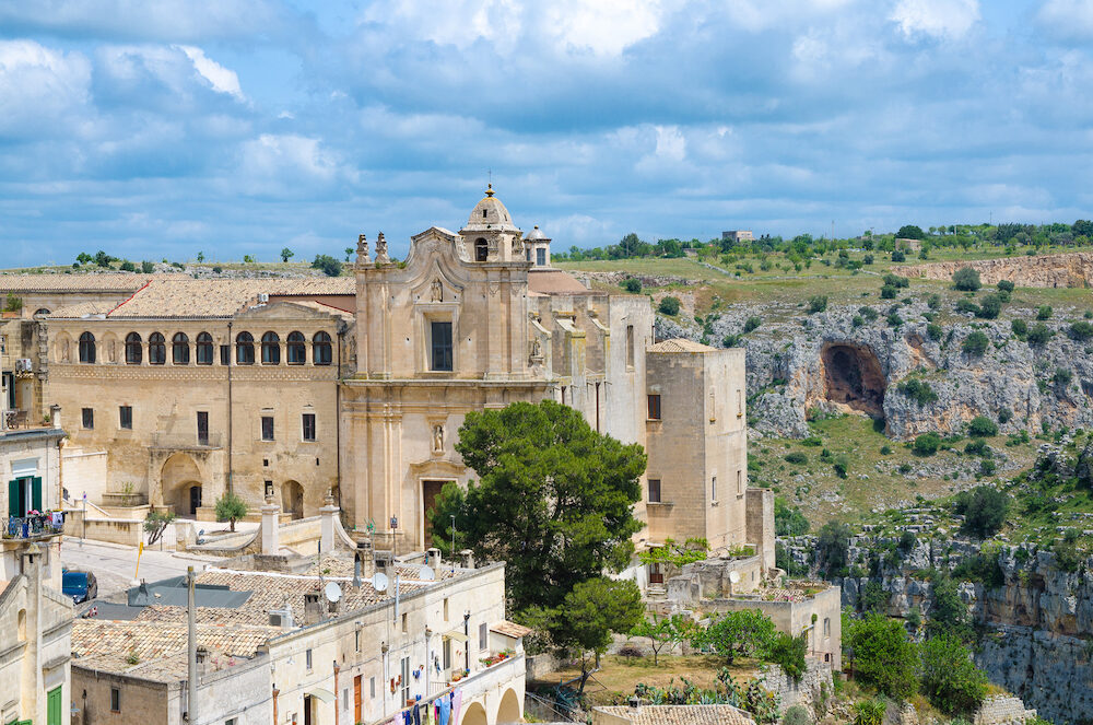 Convent of Saint Agostino church in historical centre Sasso Barisano of old ancient town Sassi di Matera with caves background, Basilicata, Southern Italy